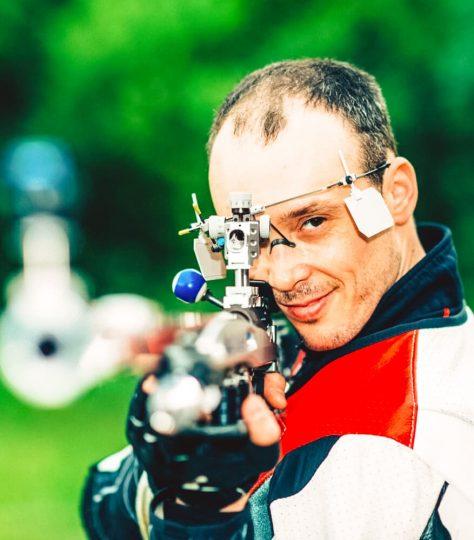 Smiling man on free rifle triaining